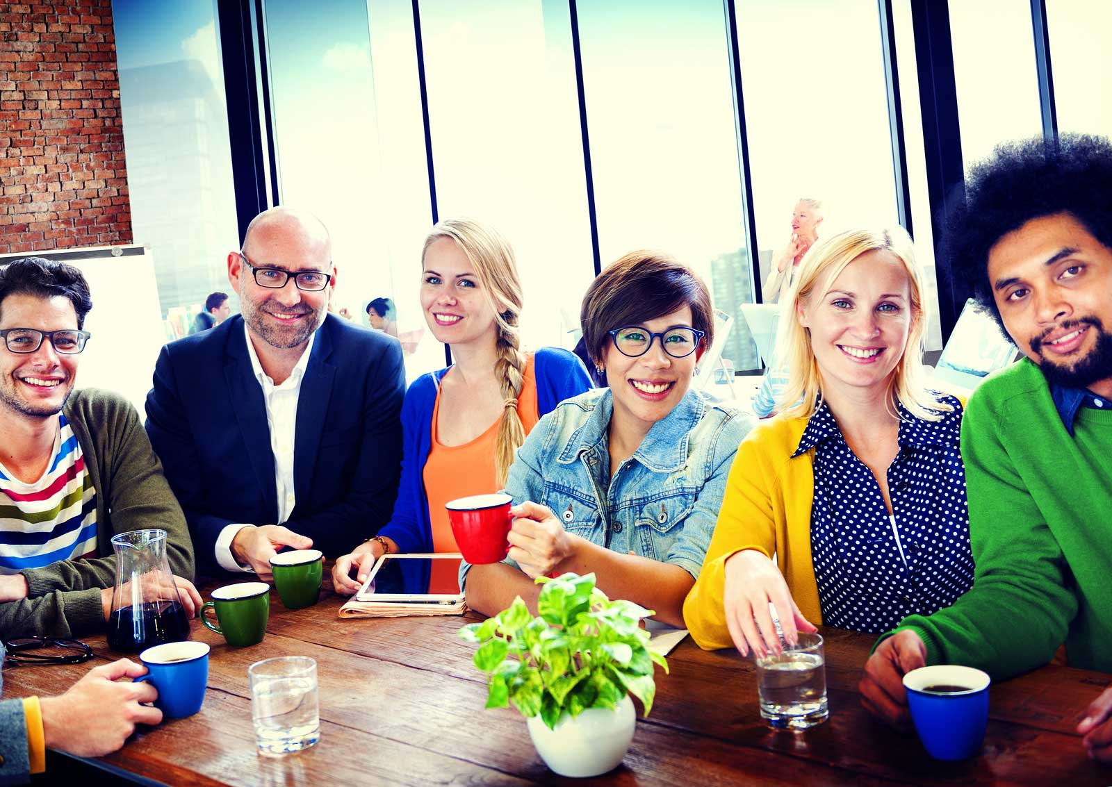 bigstock-Group-of-People-Cheerful-Team--100381634
