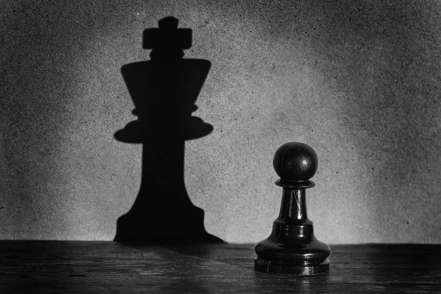 bigstock-Chess-Pawn-Standing-In-A-Spotl-60661814